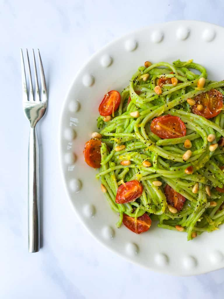 Avocado Pesto Pasta with Roasted Tomatoes and Pine Nuts. Vegan, GF & Healthy!