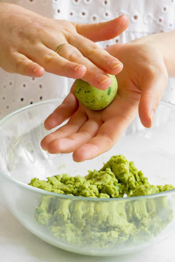 Rolling the falafel mixture into balls.