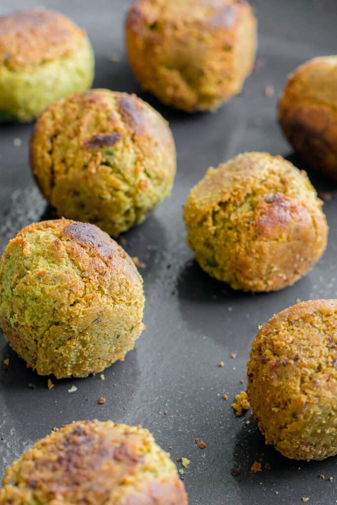 Cooked falafel in a frying pan.