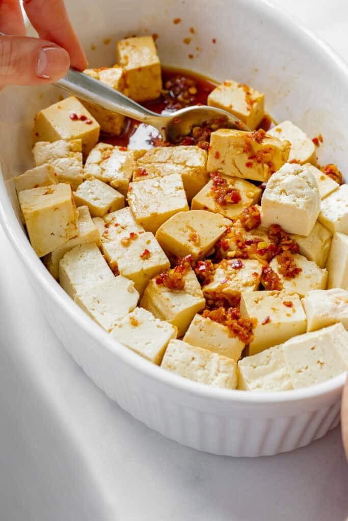 Tofu marinating in chilli-ginger sauce.