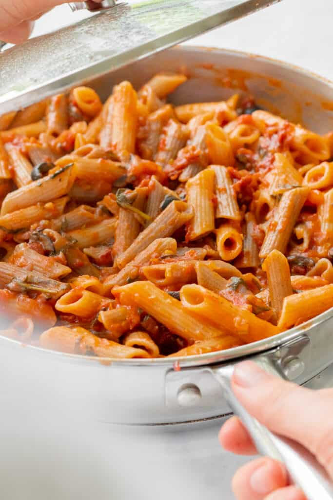 Removing the lid from the One-Pot Sun-Dried Tomato Pasta - Vegan, GF & Healthy! Georgie Eats