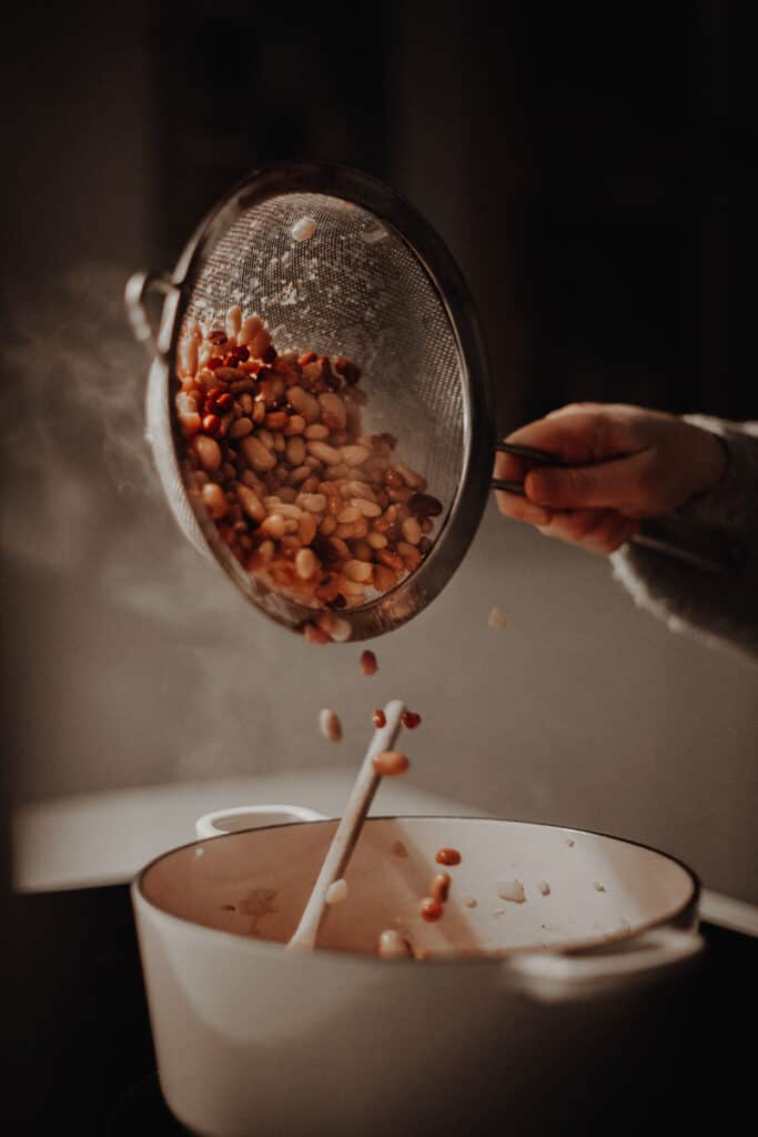 Pouring beans into the casserole dish.