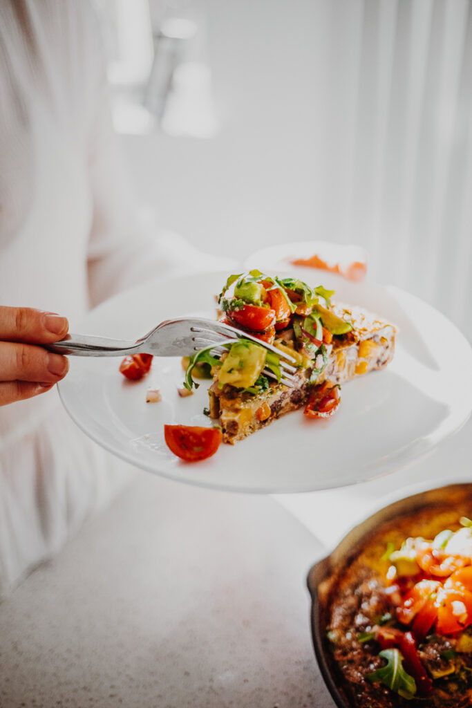 A slice of Mexican Frittata with Avocado Salsa - GF & Healthy! Georgie Eats.