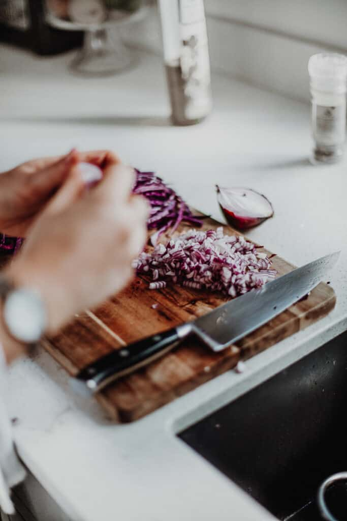 finely dicing a red onion.