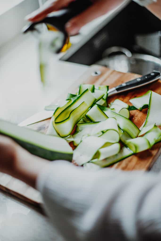 Peeling a courgette with a speed peeler.