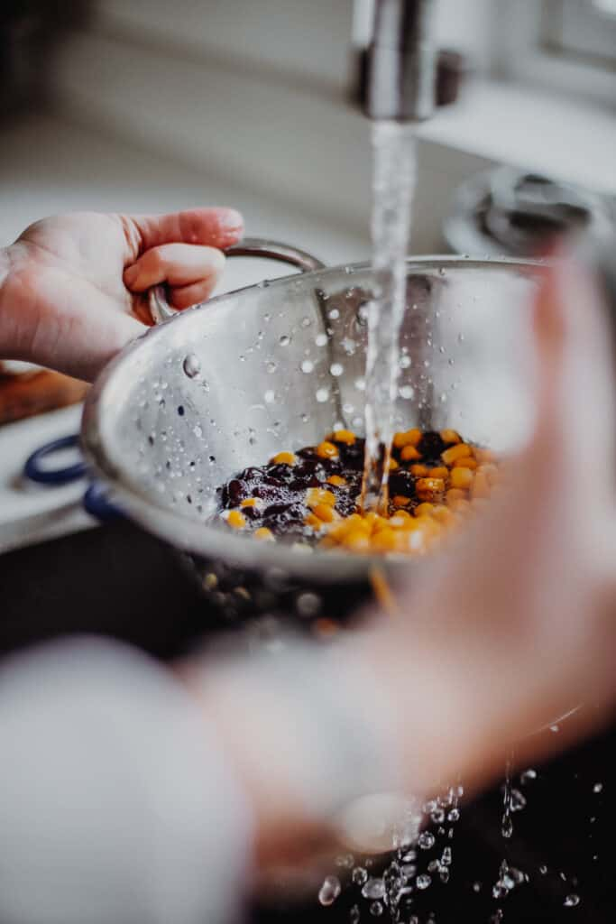 rinsing the black beans and sweetcorn