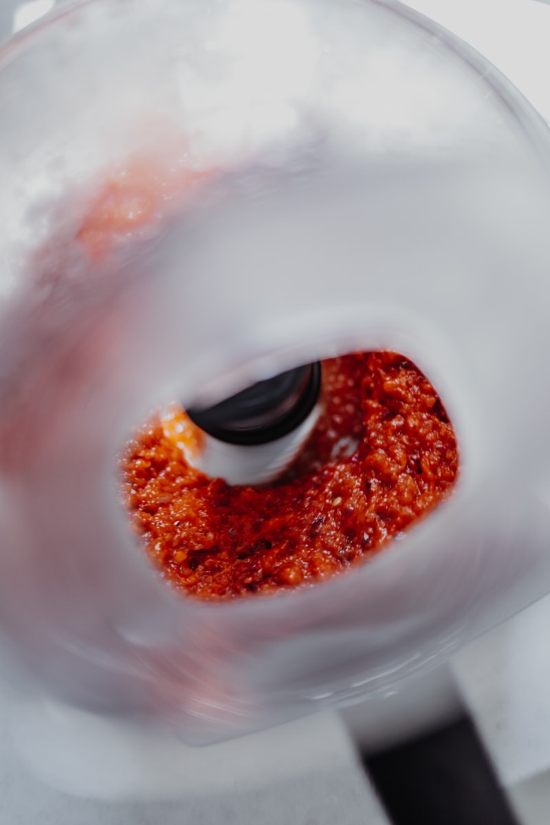 Blending the roasted red pepper & sundried tomato sauce