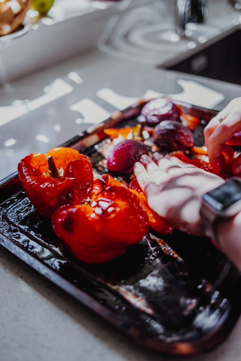 Removing the skin from the roasted red peppers