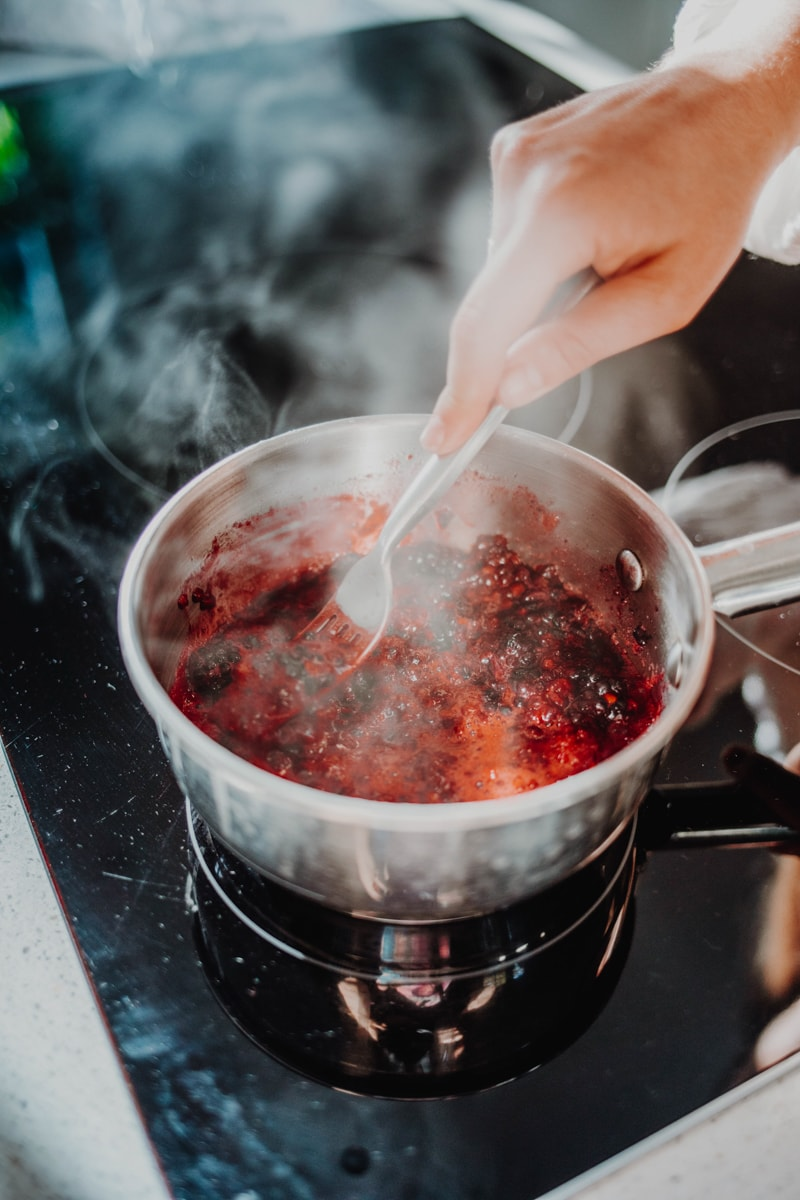 making the blackberry chia jam in a saucepan over the stove