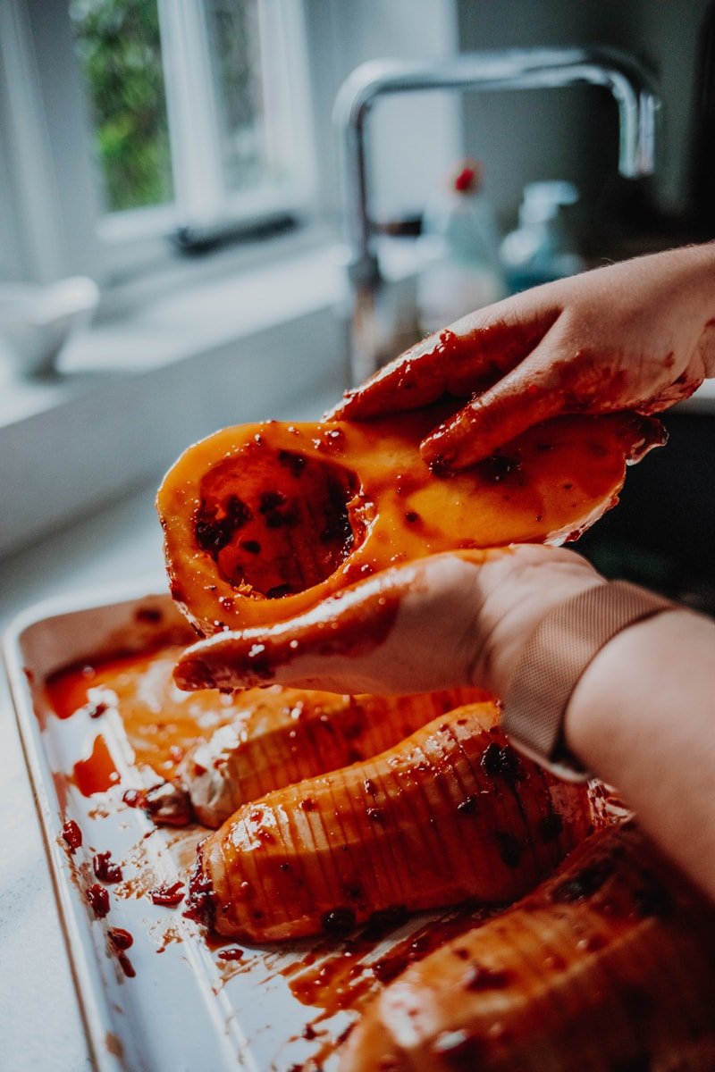 rubbing the marinade over the squash