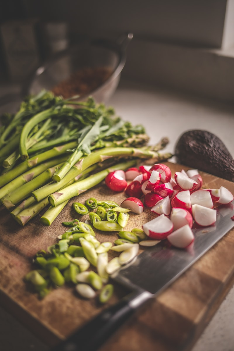 Tenderstem broccoli, radish and spring onion on a chopping board